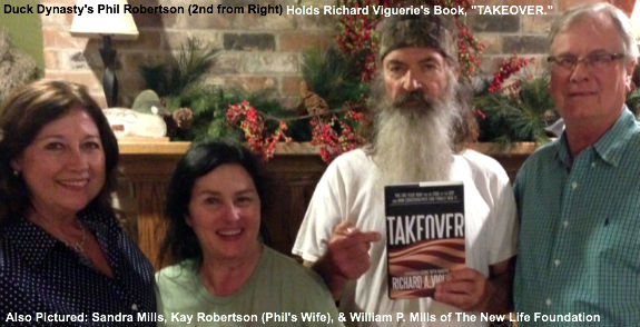 Phil Robertson holds a copy of Takeover